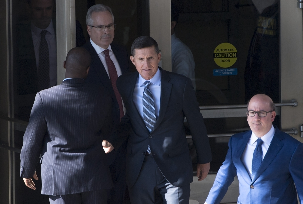 Gen. Michael Flynn, center, former national security adviser to US President Donald Trump, leaves Federal Court in Washington in this Dec. 1, 2017 file photo. — AFP