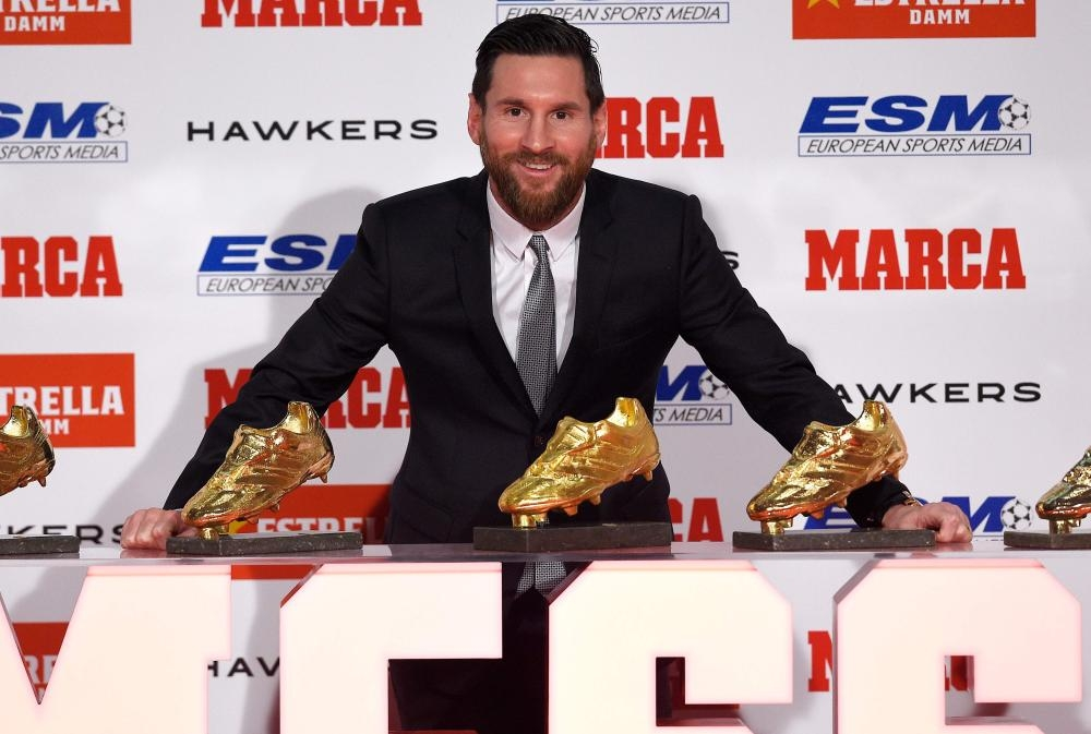 Lionel Messi poses with his five Golden Shoe awards after receiving the 2018 European Golden Shoe honoring the year's leading goalscorer during a ceremony at the Antigua Fabrica Estrella Damm in Barcelona Tuesday. — AFP