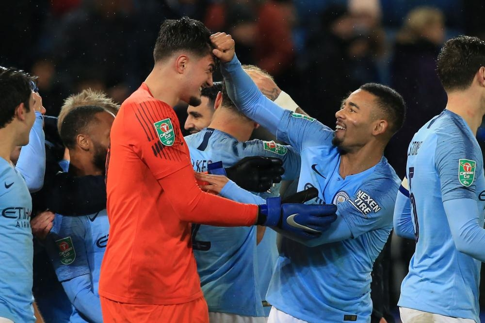 Gabriel Jesus (R) of Manchester City celebrates with Kosovan goalkeeper Arijanet Muric after the English League Cup quarterfinal match against Leicester City at King Power Stadium in Leicester Tuesday. — AFP