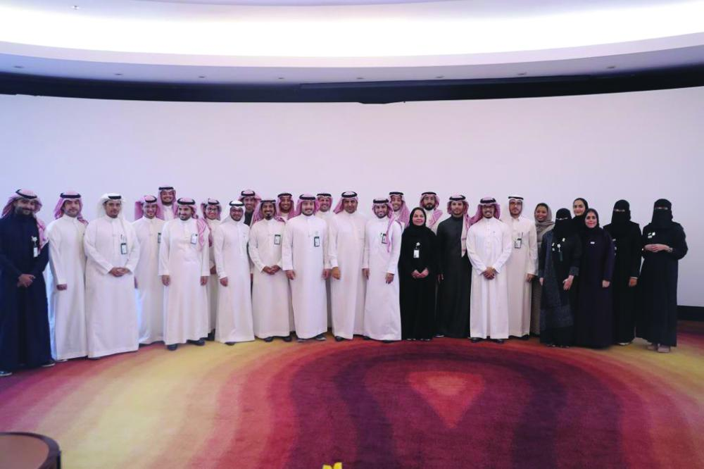Graduates group photo with Faraj Al Monajjam, SAGIA Undersecretary for Back Office Services