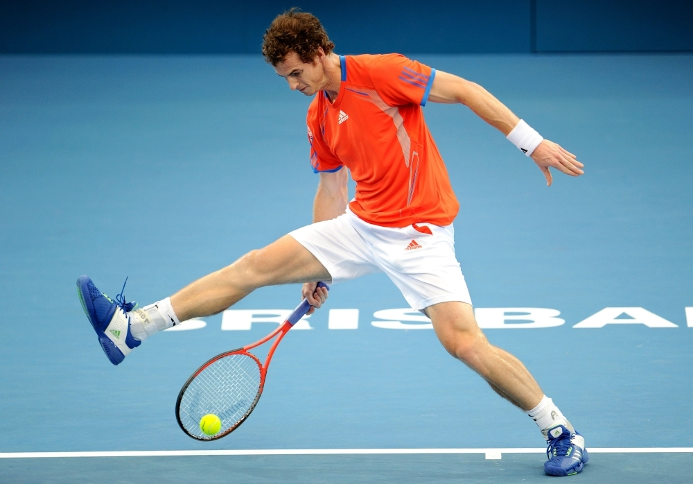 In this file photo Andy Murray of Britain hits a shot between his legs on the way to winning his quarterfinal match against Marcos Baghdatis of Cyprus, at the Brisbane International tennis tournament in Brisbane.  — AFP