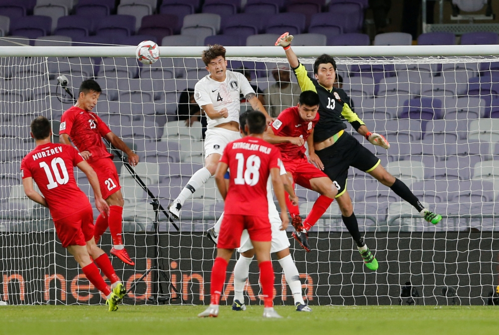 South Korea's Kim Minjae in action with Kyrgyzstan's Kutman Kadyrbekov in the Group C match of the AFC Asian Cup at the Hazza Bin Zayed Stadium, Al Ain, United Arab Emirates, on Friday. — Reuters