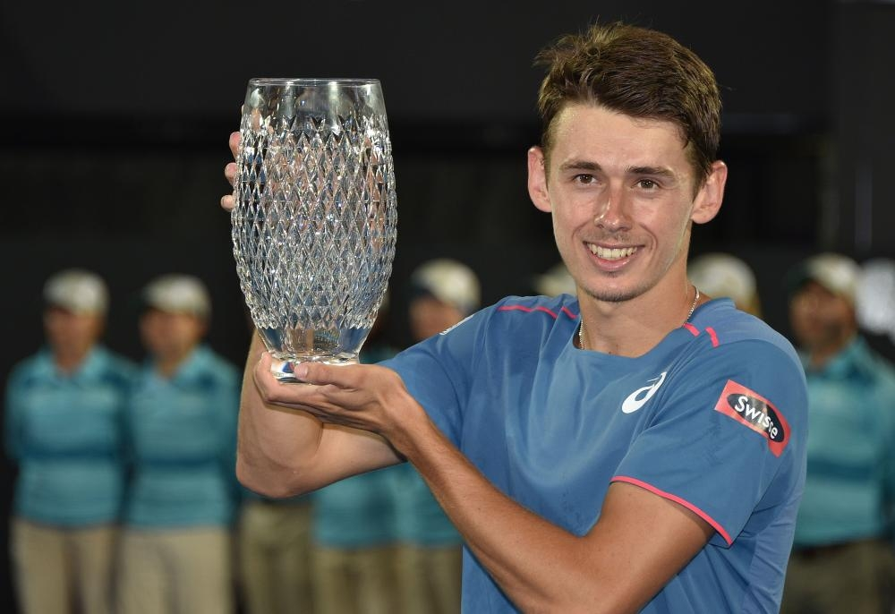 Australia's Alex De Minaur holds the trophy after beating Andreas Seppi of Italy in the final at the Sydney International Tennis Tournament Saturday. — AFP