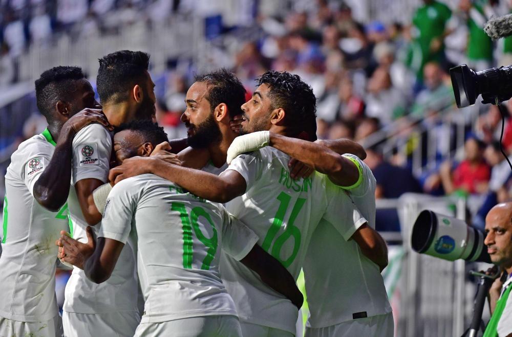 Saudi Arabia's midfielder Hussain Al-Moqahwi (R) celebrates after scoring a goal during the 2019 AFC Asian Cup Group E match against Lebanon at the Maktoum Bin Rashid Al-Maktoum Stadium in Dubai Saturday. — AFP