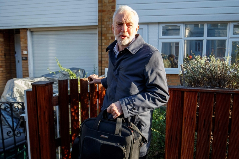 Britain's main opposition Labour Party leader Jeremy Corbyn leaves his home in London on Monday.