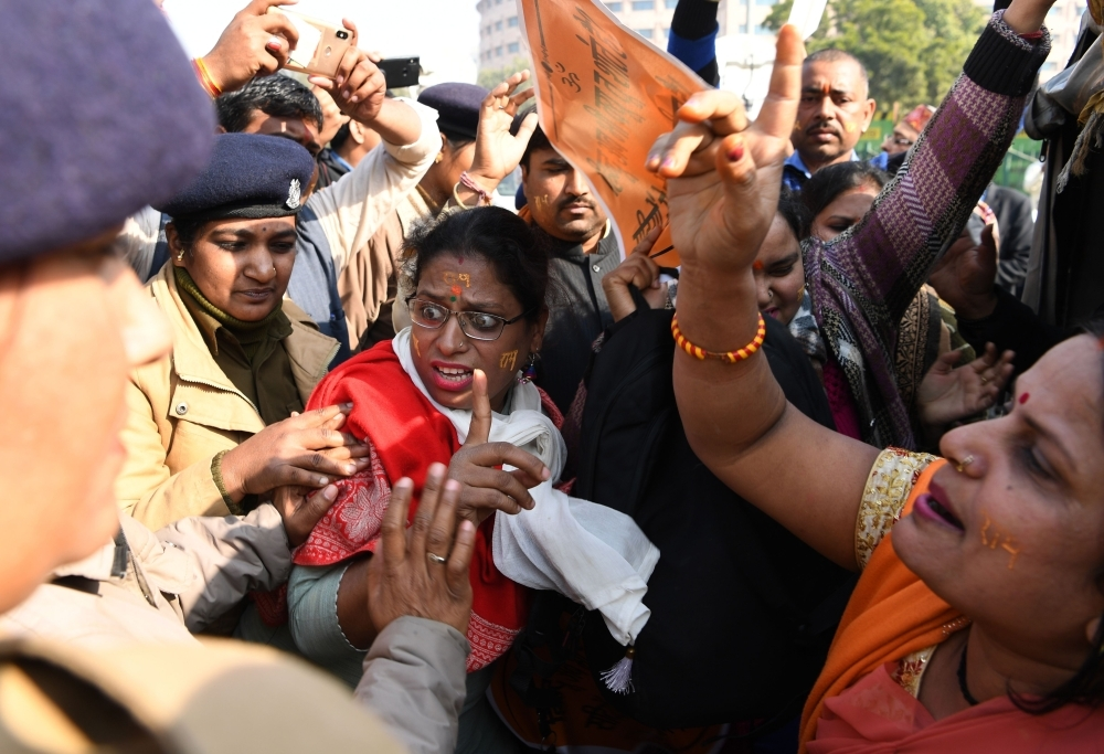 Indian police officers detain Hindu protesters as they shout slogans outside the Indian Supreme Court in New Delhi on Jan. 10, 2019, after the hearing in Babri Masjid-Ram Mandir Land dispute case was further deferred to Jan. 29. — AFP