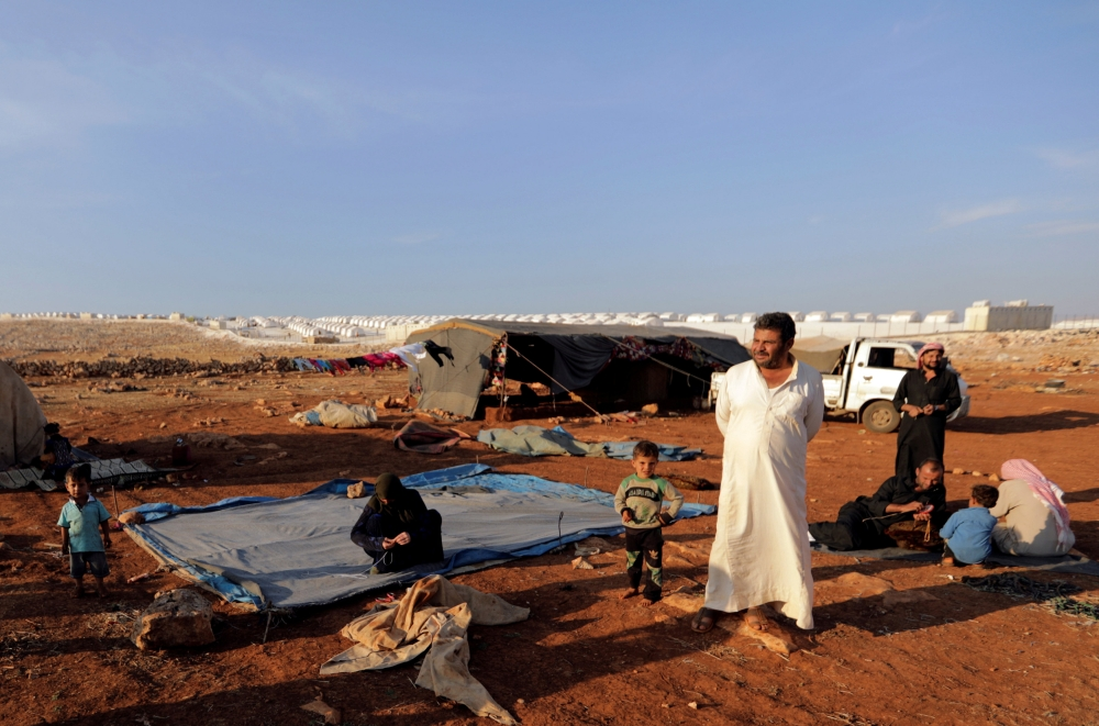 Syrians arrive in a refugee camp in Idlib's Atimah village.