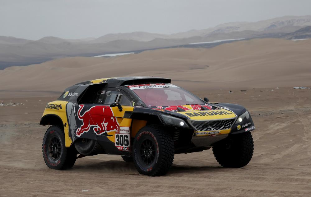 PH Sport's driver Sebastian Loeb and co-driver Daniel Elena in action during the Dakar Rally in Peru Tuesday. — Reuters