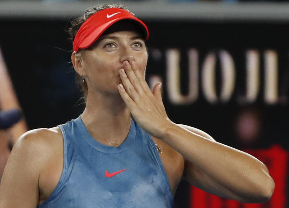 Russia's Maria Sharapova celebrates after winning her match against Sweden's Rebecca Peterson at the Australian Open in Melbourne Wednesday. — Reuters