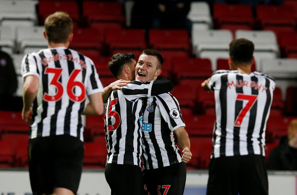 Newcastle United's Callum Roberts celebrates scoring their second goal with teammates against Blackburn Rovers during a FA Cup third round replay at Ewood Park, Blackburn, Tuesday. — Reuters