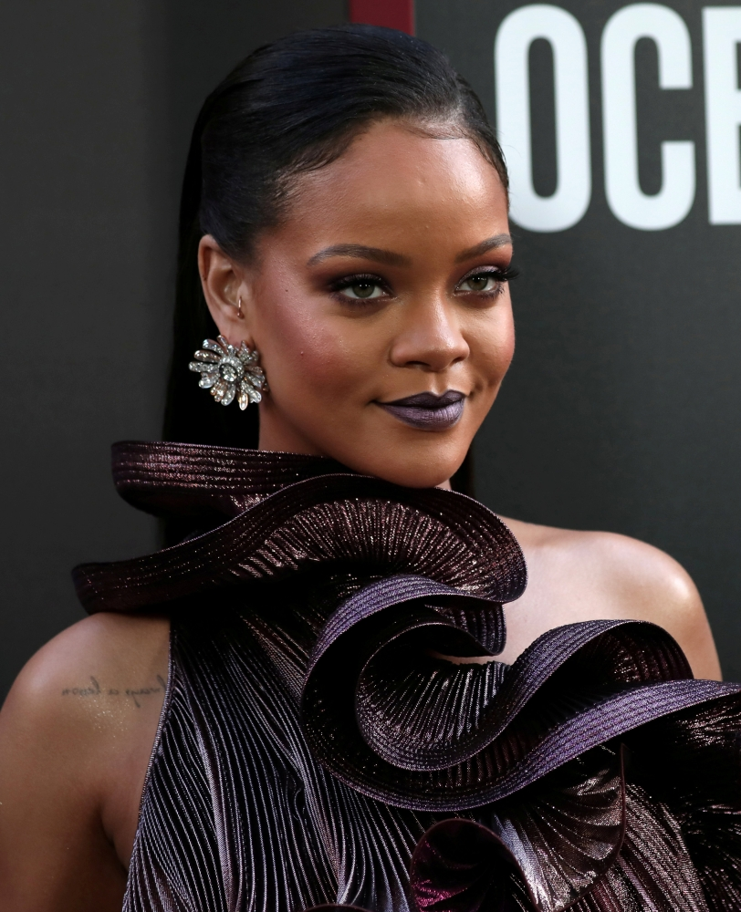 FILE PHOTO: Cast member Rihanna poses as she arrives at the world premiere of the film 'Ocean's 8' at Alice Tully Hall in New York City, New York, U.S., June 5, 2018. REUTERS/Mike Segar/File Photo