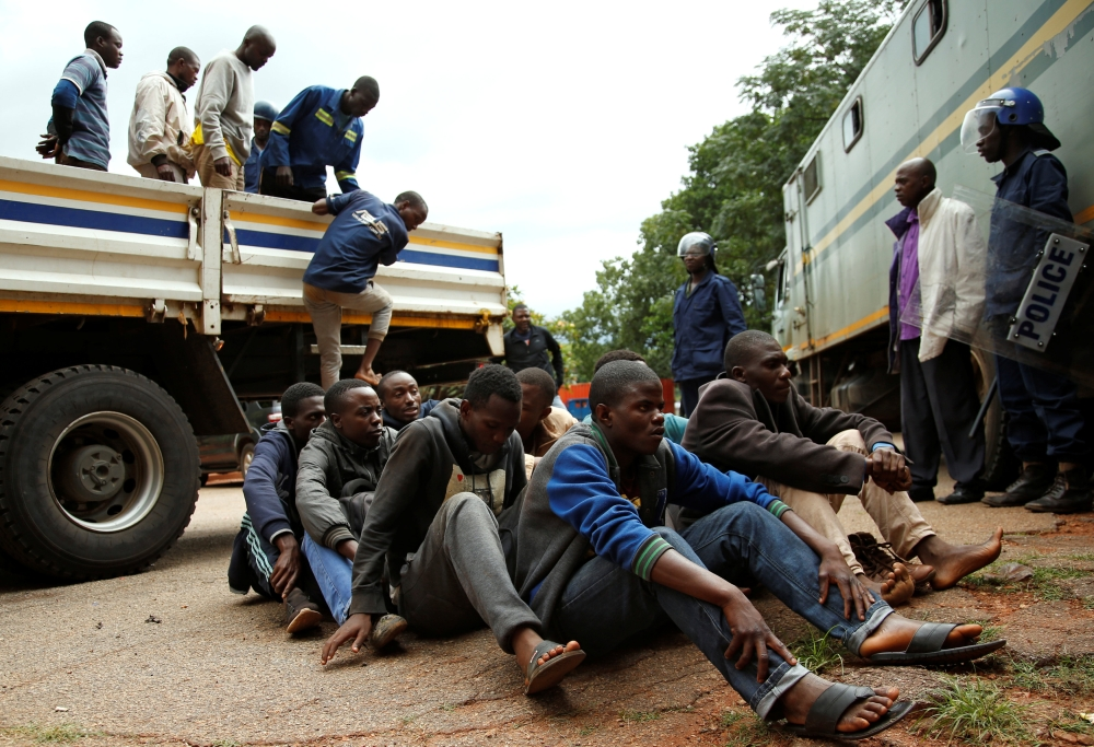 People arrested during protests wait to appear in the Magistrates court in Harare, Zimbabwe, on Wednesday. — Reuters