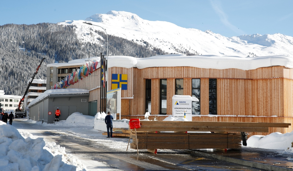 Snow-covered mountains are seen behind the congress center, the venue of the World Economic Forum (WEF) in Davos, Switzerland, on Tuesday. — Reuters