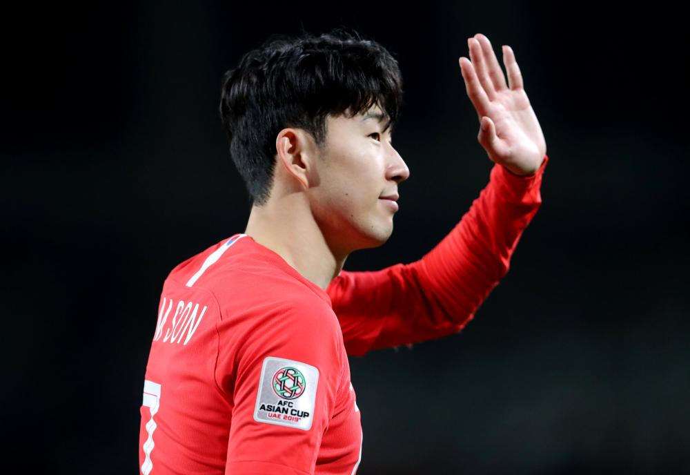 South Korea's Son Heung-min waves to the fans after their Group C match of the Asian Cup against China at Al Nahyan Stadium in Abu Dhabi Wednesday. — Reuters