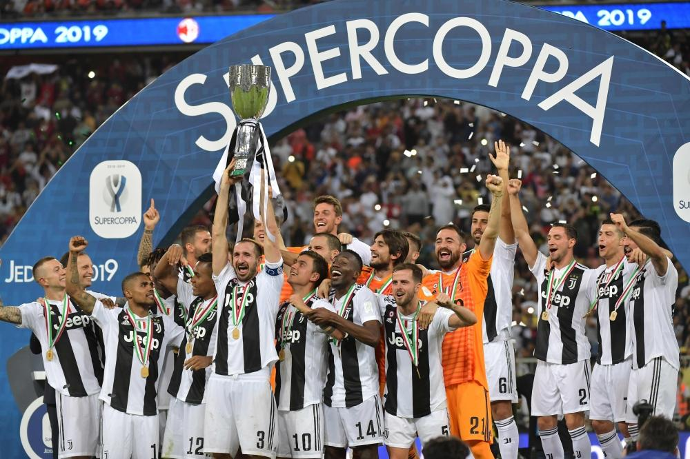 Juventus' Italian defender Giorgio Chiellini lifts the Supercoppa Italiana after winning the final against AC Milan at the King Abdullah Sports City Stadium in Jeddah Wednesday. — AFP