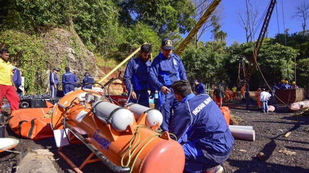 Indian Navy personnel prepare for rescue operations after 15 miners were trapped by flooding in an illegal coal mine in Ksan village in Meghalaya's East Jaintia Hills district of India in this file photo. — AFP