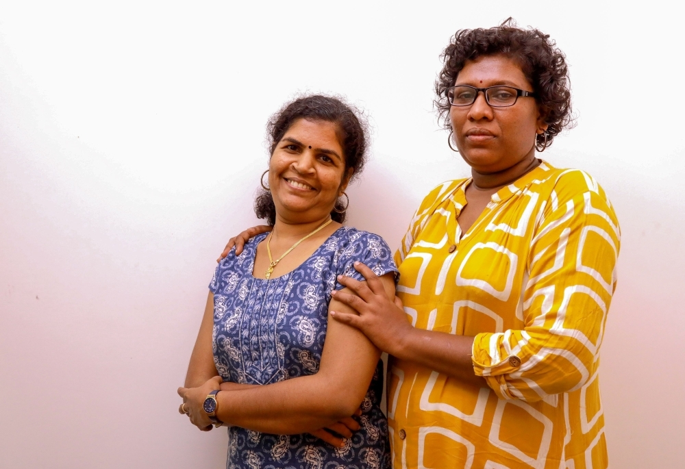 Bindu Ammini, right, and Kanakadurga, left, the two Indian women who entered the Sabarimala Ayyapa temple, pose for photographs during an interview with the media in Kochi in the southern state of Kerala in this Jan. 11, 2019 file photo. — AFP
