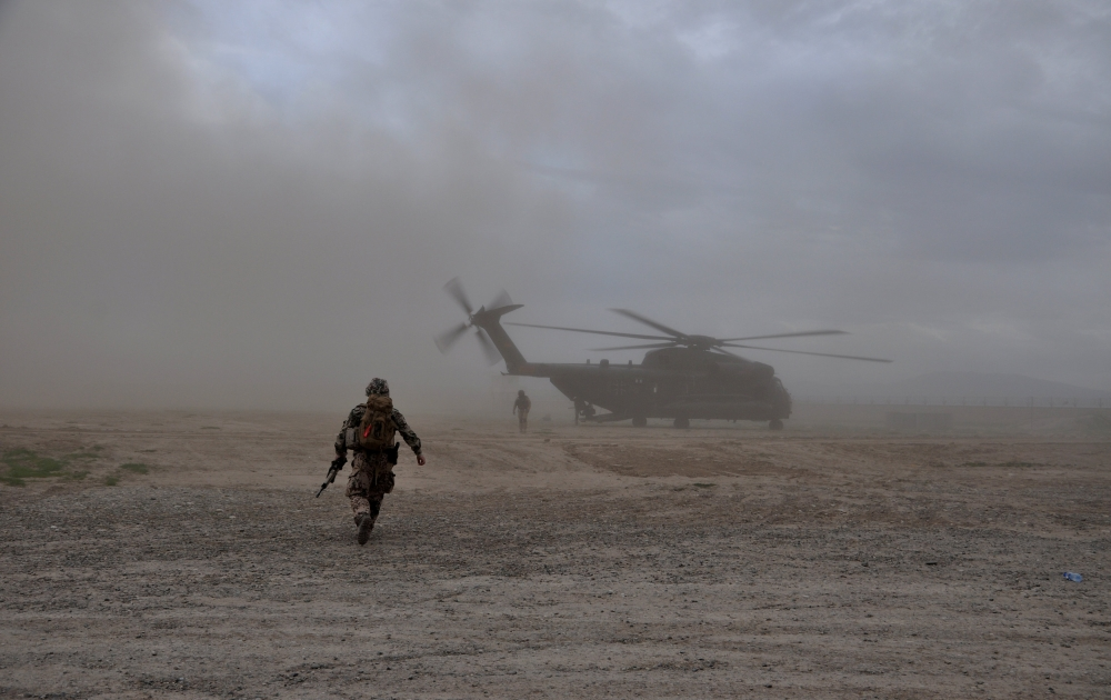 A soldier walks toward a CH-53 helicopter in Kunduz, Afghanistan, in this March 27, 2017 file photo. — Reuters