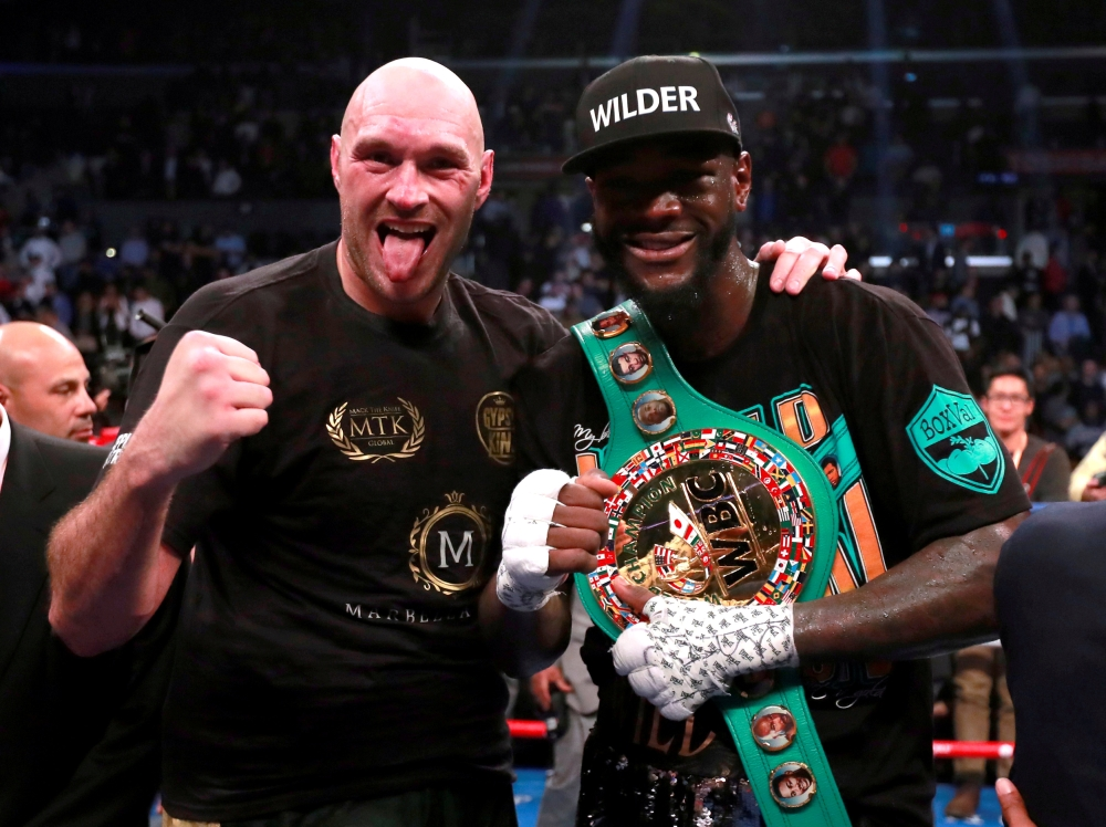 Deontay Wilder and Tyson Fury after the WBC World Heavyweight title fight at the Staples Centre, Los Angeles, United States in this recent photo. — Reuters