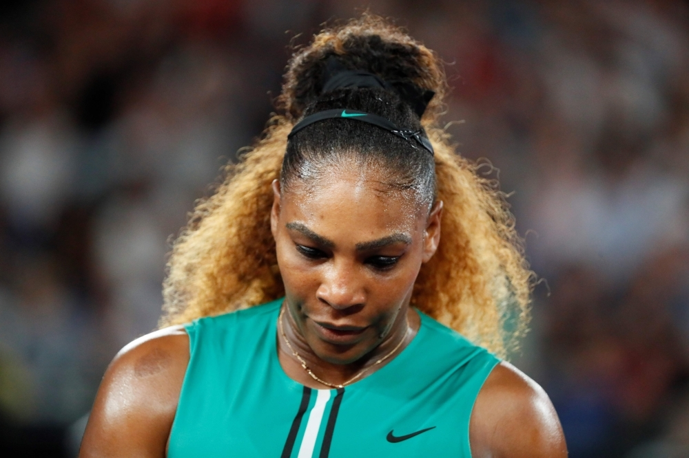 Serena Williams of the US walks on court between points against Canada's Eugenie Bouchard during their women's singles match on day four of the Australian Open tennis tournament in Melbourne on Thursday. — AFP