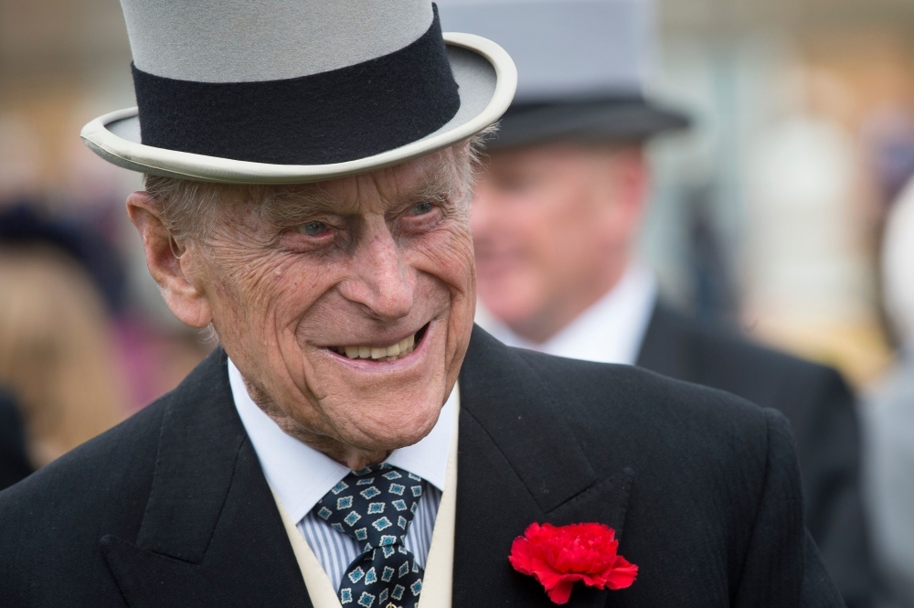 Prince Philip, Duke of Edinburgh, greets guests at a garden party at Buckingham Palace in London in this May 16, 2017 file photo. — AFP