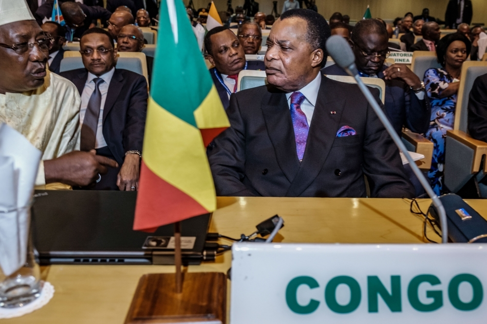 Republic of the Congo's President Denis Sassou Nguesso, right, and Chadian President Idriss Deby, left, speak together before a High Level Consultation Meeting with African leaders on D.R. Congo election at the AU headquarters in Addis Ababa on Friday. — AFP