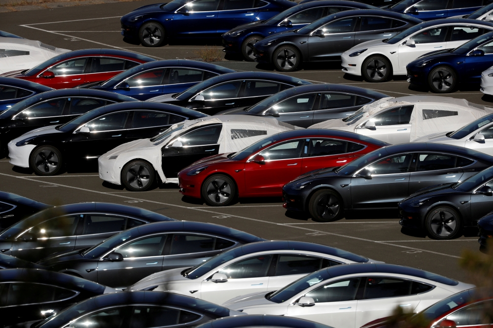 Rows of new Tesla Model 3 electric vehicles are seen in Richmond, California, in this recent photo. — Reuters