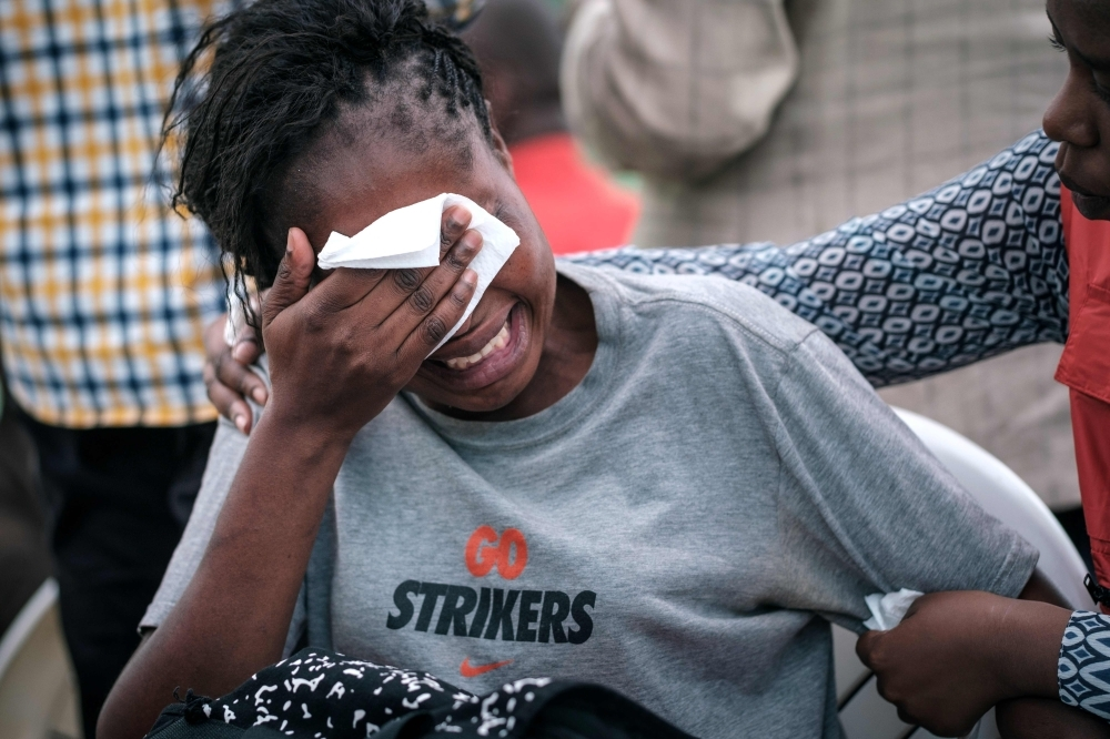 A woman reacts at the Chiromo mortuary, where are kept the bodies of the victims of a militant attack two days prior at the DusitD2 luxury hotel complex, in Nairobi, on Friday. — AFP