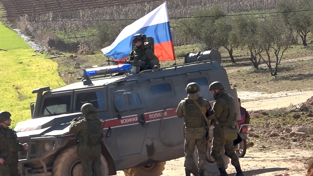 A Russian army vehicle patrols in the area of Arimah, just west of Manbij, the northern city near the Turkish border where a day earlier a suicide attack on a restaurant killed four US personnel, on Thursday. — AFP