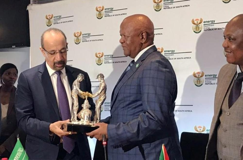 Minister of Energy, Industry and Mineral Resources Khalid Al-Falih exchanges gifts with his counterpart, South Africa's Energy Minister Jeff Radebe, during their bilateral meeting in Pretoria. — Reuters