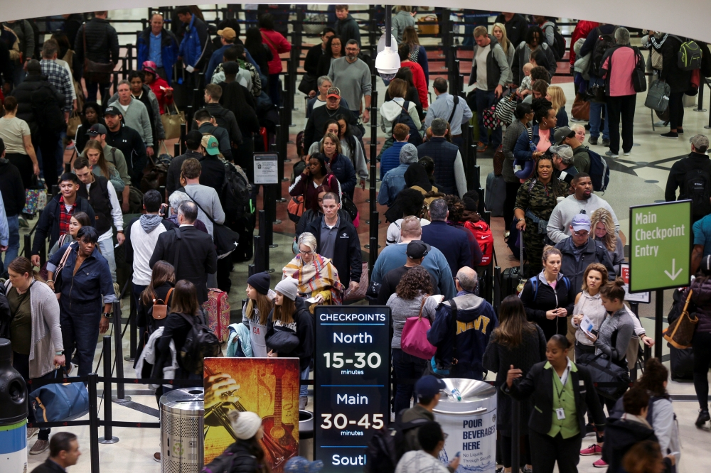Long lines are seen at a Transportation Security Administration (TSA) security checkpoint at Hartsfield-Jackson Atlanta International Airport amid the partial federal government shutdown, in Atlanta, Georgia, on Friday. — Reuters
