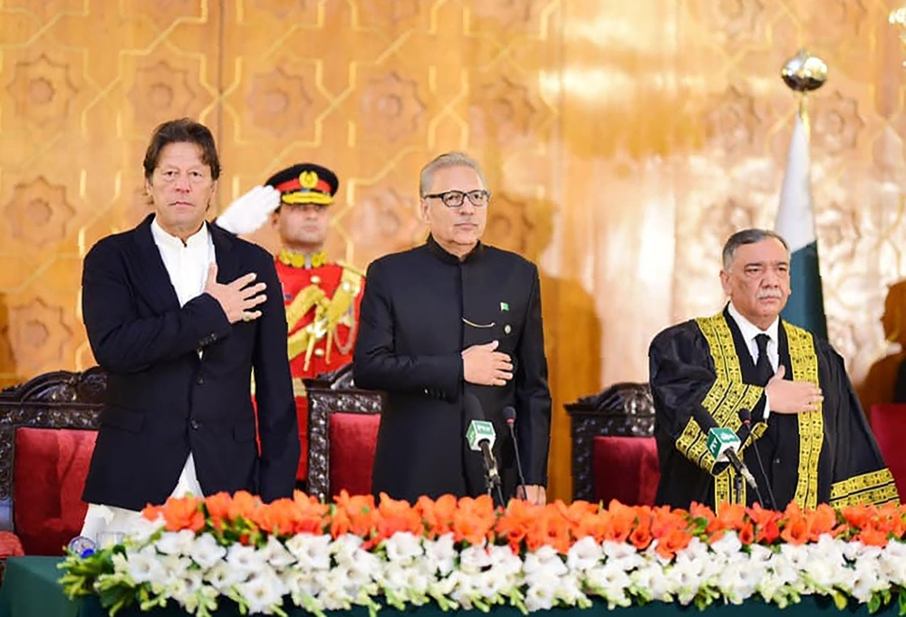 Pakistani Prime Minister Imran Khan, left, Pakistani President Arif Alvi, center, and newly appointed Chief Justice of the Pakistan Supreme Court Asif Saeed Khosa, right, stand for the national anthem during the oath-taking ceremony for new chief justice in Islamabad on Friday. — AFP