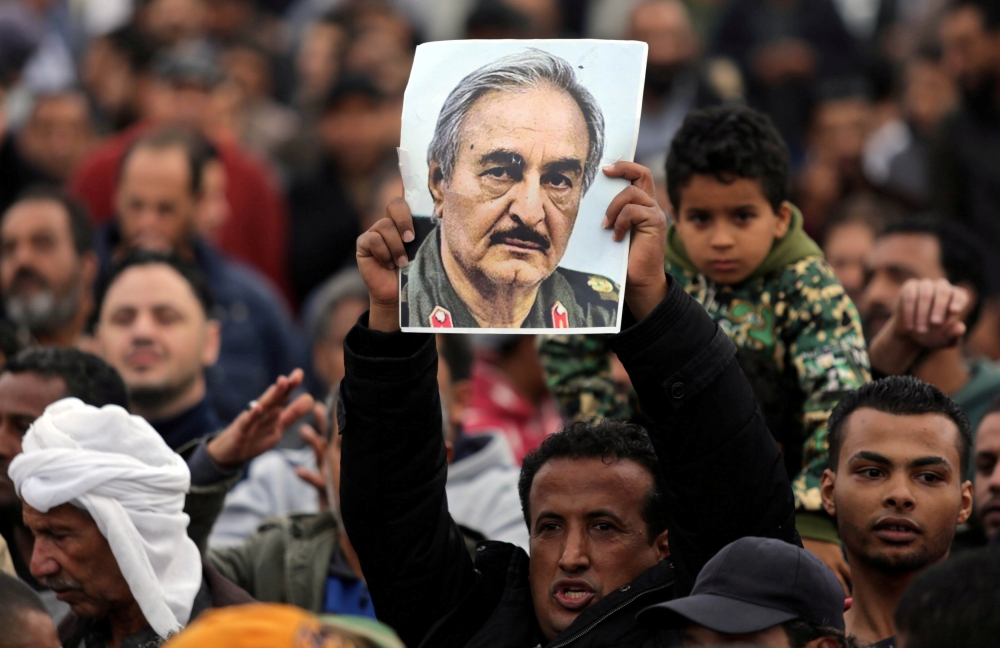 A man holds a poster of Eastern Libyan military commander Khalifa Haftar during a rally in Benghazi, Libya, in this Dec. 17, 2017 file photo. — Reuters