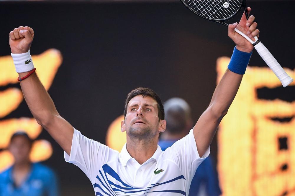 Serbia's Novak Djokovic celebrates his victory over Canada's Denis Shapovalov at the Australian Open Tennis Tournament in Melbourne Saturday. — AFP