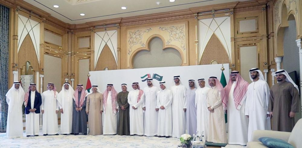 The members of the Executive Committee of the Saudi-UAE Coordination Council at the first meeting in Abu Dhabi. — SPA