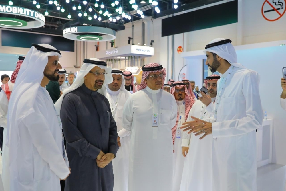 Khalid Al-Falih, Minister of Energy, Industry and Mineral Resources of Saudi Arabia and Mohammed Al Tuwaijri, Minister of Economy and Planning of Saudi Arabia on a tour of the ACWA Power and Saudi pavilion