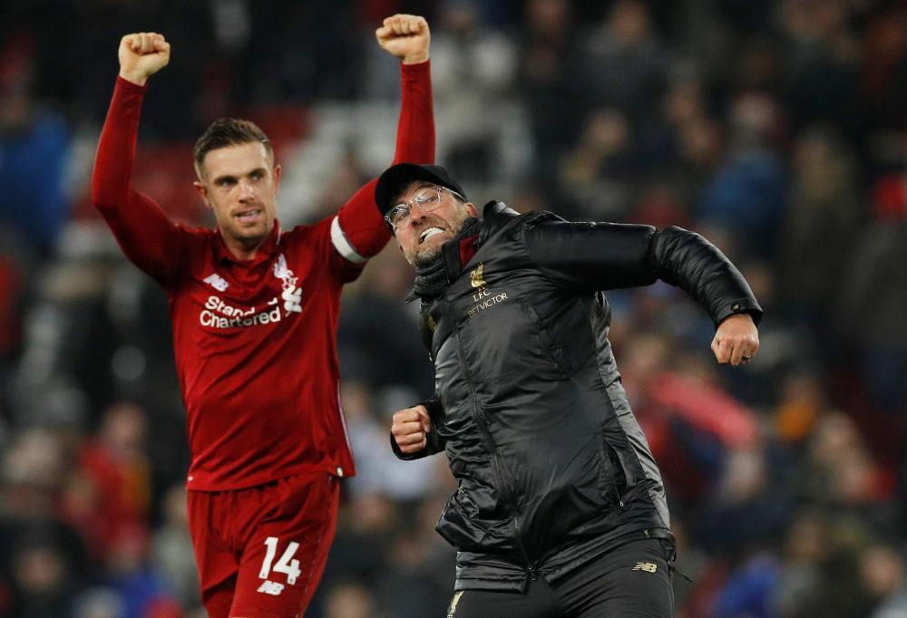 Liverpool manager Juergen Klopp and Jordan Henderson celebrate at the end of the match against Crystal Palace at Anfield, Liverpool, Saturday. — Reuters