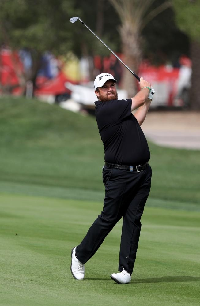 Shane Lowry of Ireland plays a shot during day four of the Abu Dhabi Golf Championship at the Abu Dhabi Golf Club Saturday. — AFP