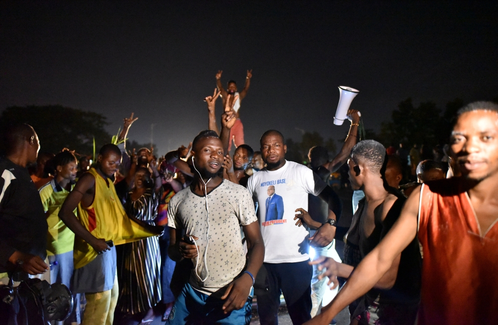 Supporters of Felix Tshisekedi, leader of the Congolese main opposition party, the Union for Democracy and Social Progress (UDPS) celebrate along the streets after the judges of the Constitutional Court confirmed Tshisekedi's victory in the presidential election in Kinshasa, Democratic Republic of Congo on Sunday. — Reuters