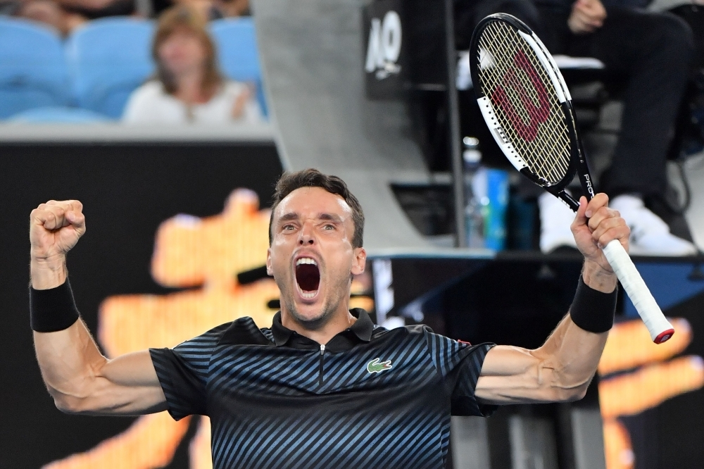 Spain's Roberto Bautista Agut celebrates his victory against Croatia's Marin Cilic at the Australian Open Tennis Tournament in Melbourne Sunday. — AFP