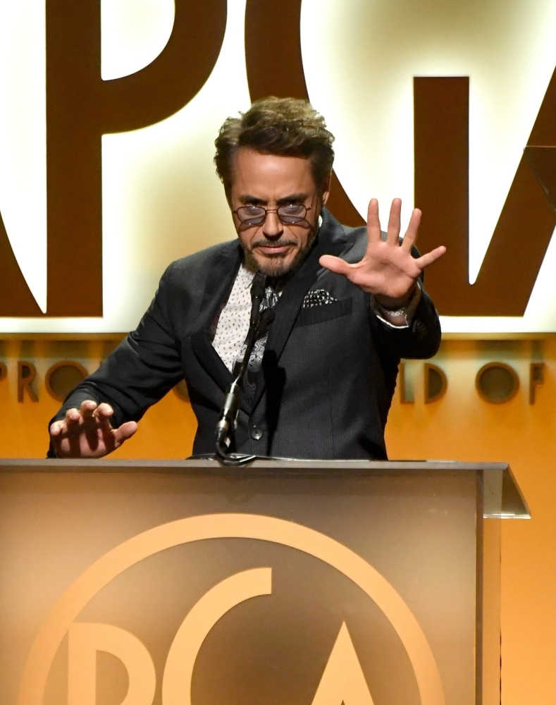 Robert Downey Jr. speaks onstage during the 30th annual Producers Guild Awards at The Beverly Hilton Hotel on Saturday in Beverly Hills, California. — AFP