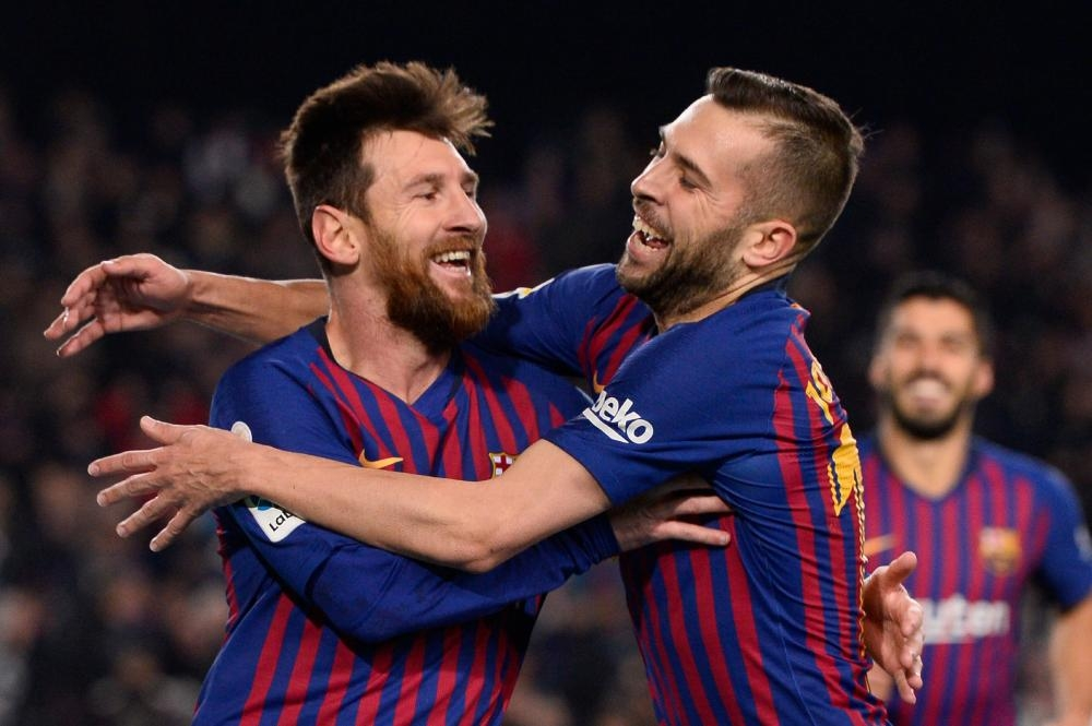 Barcelona's forward Lionel Messi (L) celebrates with defender Jordi Alba after scoring during the Spanish League football match against Leganes at the Camp Nou Stadium in Barcelona Sunday. — AFP