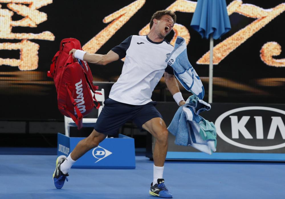 Pablo Carreno Busta of Spain reacts after losing the match against Kei Nishikori of Japan at the Australian Open Monday. — Reuters