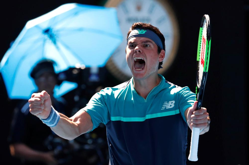 Canada's Milos Raonic celebrates winning his match against Germany's Alexander Zverev at the Australian Open in Melbourne Monday. — Reuters