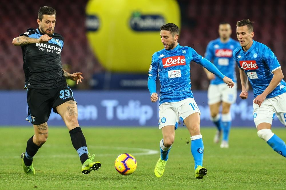 Lazio's defender Francesco Acerbi (L) and Napoli's forward Dries Mertens go for the ball during their Italian Serie A football match at the San Paolo Stadium in Naples Sunday. — AFP