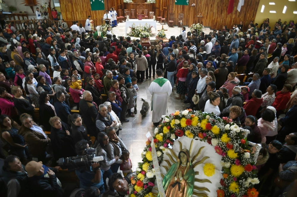 Relatives of three of the 85 people killed in a massive blaze triggered by a leaky pipeline in Tlahuelilpan, attend their funeral in Teltipan de Juarez community, in Hidalgo state, Mexico, on Sunday. — AFP