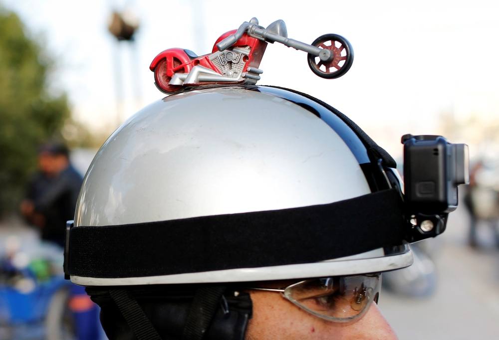 A motorbike dummy is seen on a biker's helmet who is a member of the Iraq Bikers, the first Iraqi biker group, in Baghdad.