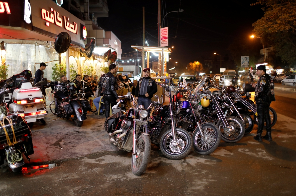 Members of the Iraq Bikers gather outside a cafe in Baghdad. — Reuters photos