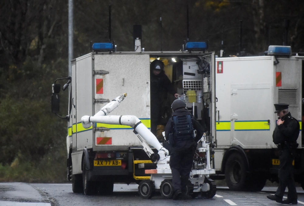 Special forces disembark an army bomb disposal robot from a truck at the scene of a security alert in Southway, Londonderry, Northern Ireland, on Monday. — Reuters