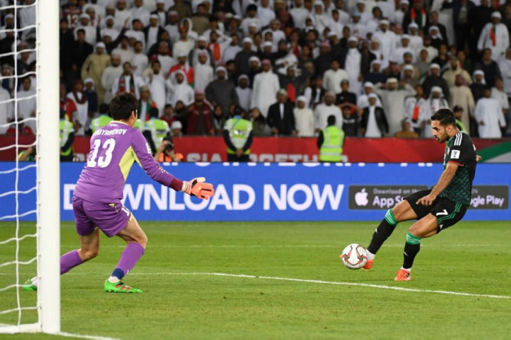 United Arab Emirates' forward Ali Mabkhout takes a shot against Kirghyzstan's goalkeeper Kutman Kadyrbekov (L) during the 2019 AFC Asian Cup Round of 16 football match between uae and Kyrgyzstan at the Zayed Sports City Stadium in Abu Dhabi on Monday. — AFP